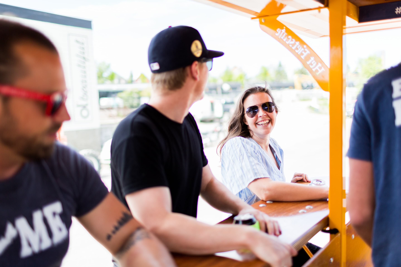 girl smiling on pedal pub bike