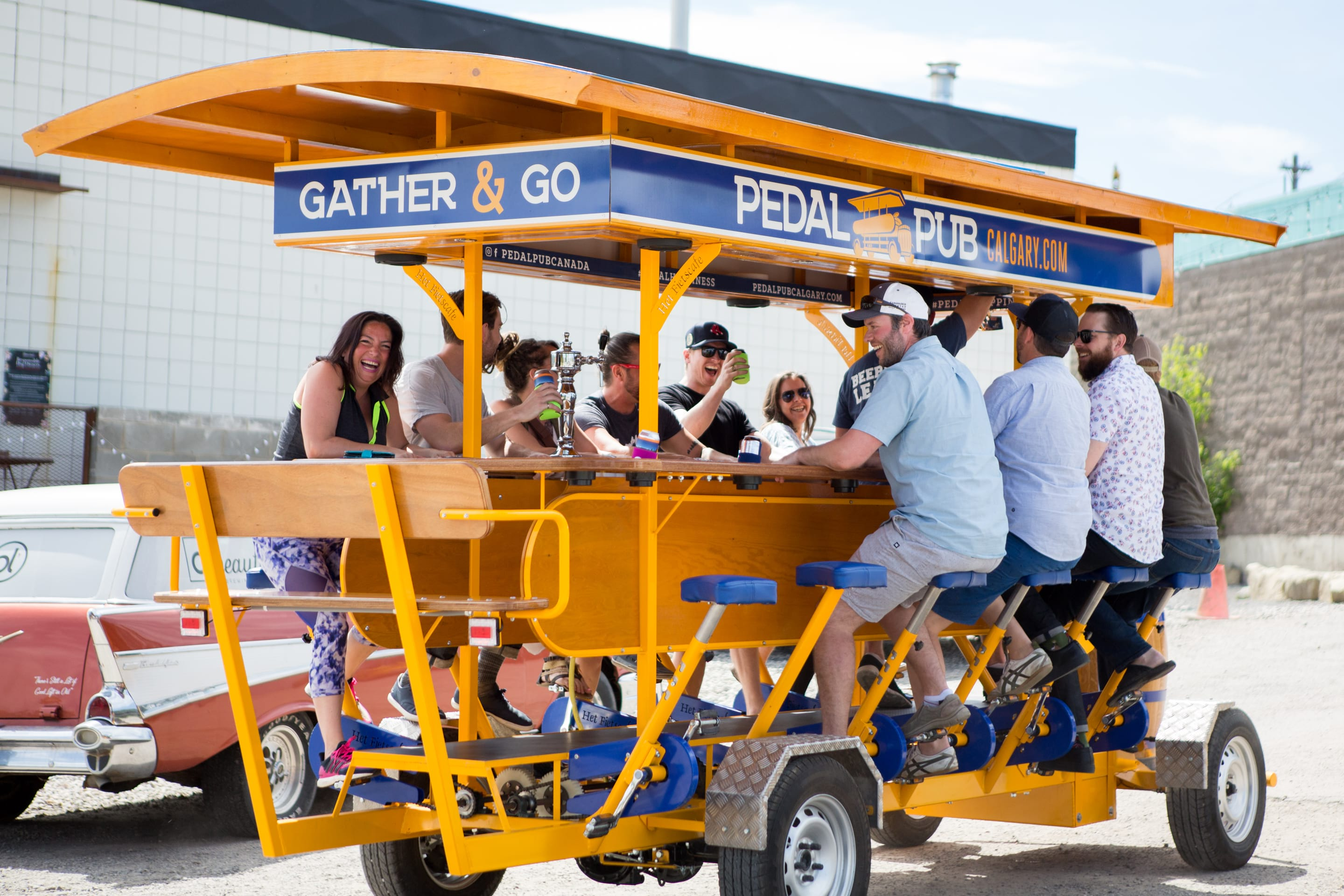 happy riders on pedal pub bike