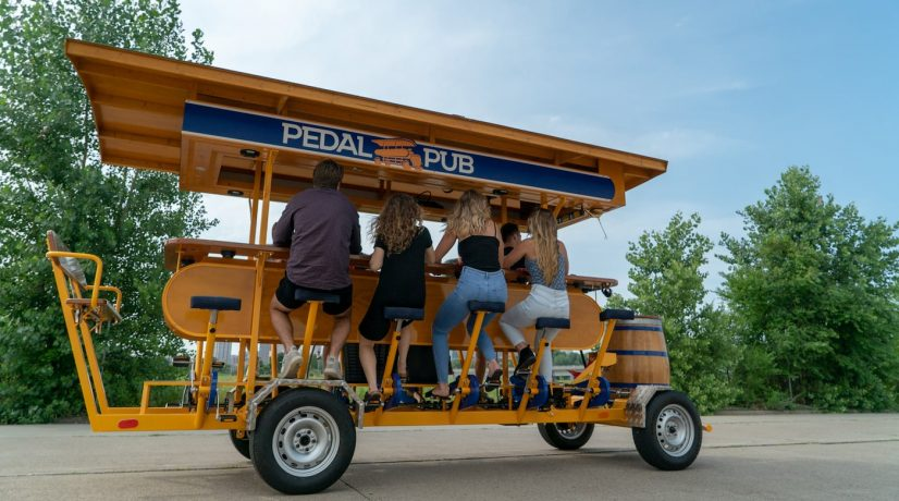 Patrons drink on 15 person Dutch party bike