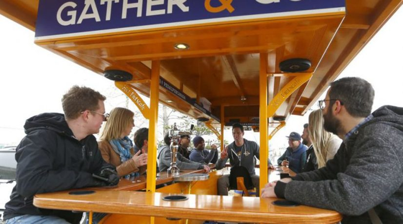 patrons drink on the 15-person Dutch party bike