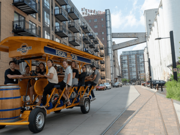 pedal pub with guests in a city